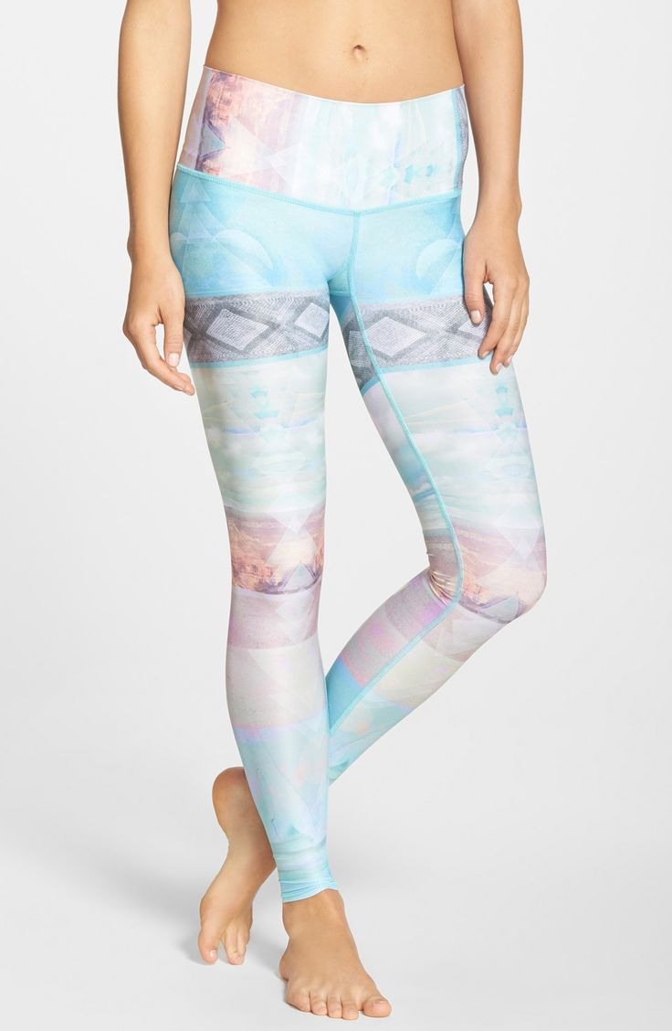 Pretty pastel hues and desert landscapes inlaid with geometric shapes adorn these super comfortable, eco-conscious yoga leggings.