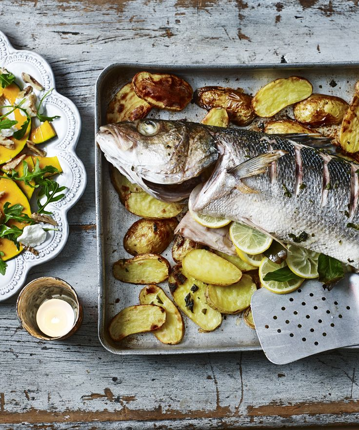Whole seabass is roasted on a layer of potatoes with herbs and a punchy dressing, served with a flavour-packed pickled walnut salad.