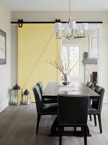A sliding barn door adds charm and a dose of color to this airy dining room. Morriston Barn Door Vanity