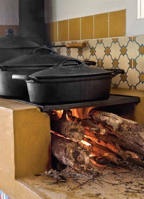 great adjunct to a kitchen fireplace - cooking ledges that fit cast iron pots - place to rise bread?
