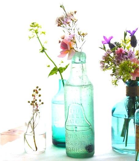 17 best images about coastal vintage bottles glass on for Flowers in glass bottles