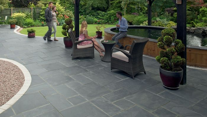 Like the dark grey (less cleaning?) with brown pebbles and border. Modern looking. (Fairstone Natural Slate Garden Paving | Marshalls.co.uk)