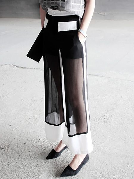Black & white trousers with sheer panels; pattern cutting; contemporary fashion details:
