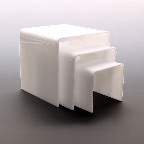 "White acrylic display risers at wholesale. Our 1/8"" wall white acrylic display risers are used in showcases, counter tops or in window displays. Gives prominence and allows for more organized and appealing display of the products you want to showcase. Great for displaying and highlighting jewelry, make-up or other light weight specialty store items. Flame …"