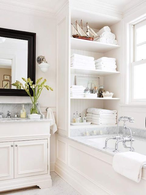 Love the side  panel on the tub and the shelves above it.