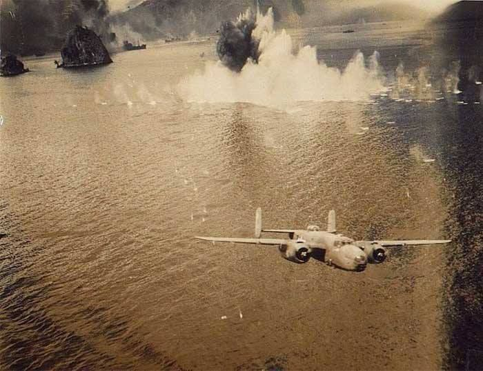 A powerful photograph of a USAAF B-25 Mitchell bomber attacking shipping in the South Pacific.