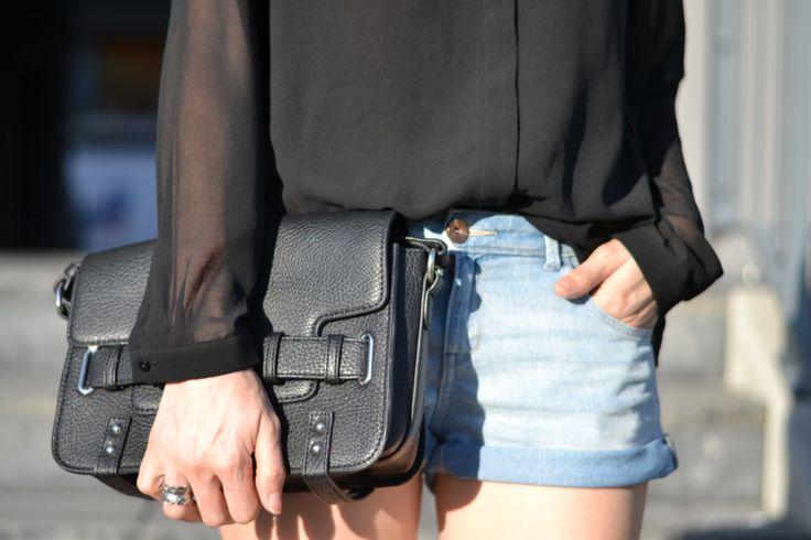 denim shorts and black shirt