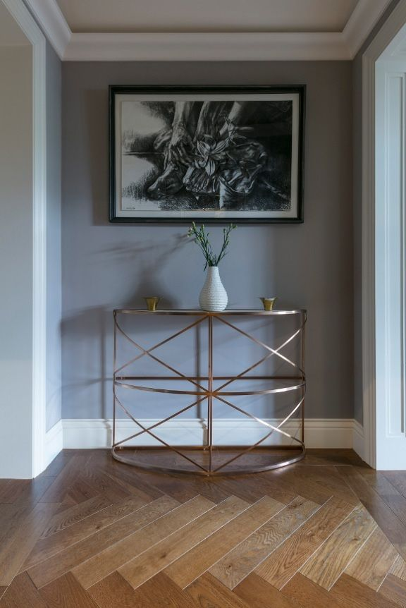 Engineered herringbone wood floors from TileStyle seen here in this stunning vestibule in a Dublin home renovated in 2017. See more photos of this inspiring interior project...  #Herringbone # Wood #Floors #Engineered #Vestibule #Hallway #Console # Table #contemporary  #modern #Home