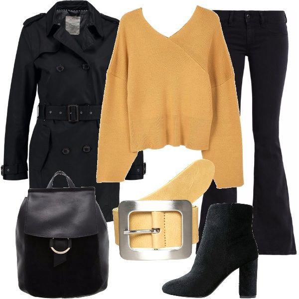 Tonalità di giallo pastello ed il nero per questo outfit per tutti i giorni, attento alla moda: maglione con ampie maniche, jeans a zampa, tronchetti in pelle e tessuto, zainetto, trench corto e per finire, cintura gialla con fibbia importante.