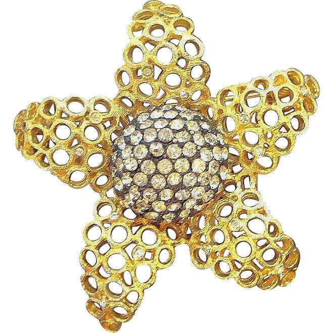 Vintage Coro Dimensional Goldtone Metal Rhinestone Flower Brooch. found at www.rubylane.com #vintagebeginshere