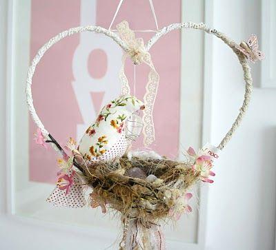 Heart shaped, handmade bird themed dream catcher serves as baby crib mobile in a baby girl nursery