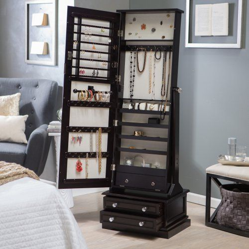 I know it's a little expensive but I really really like this!!!!!!! follow the link...... Belham Living Swivel Cheval Jewelry Armoire - Espresso - Floor Mirrors at Hayneedle
