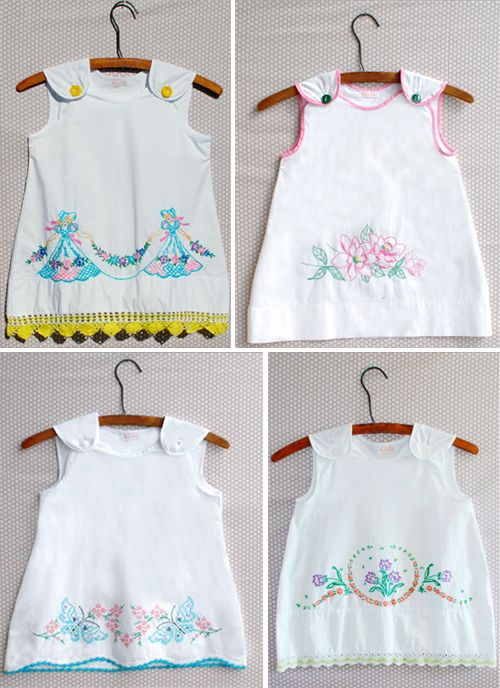 Children's dresses made from embroidered pillow cases.