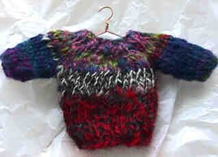 Miniature Sweater Ornament for your tree. Free knitting pattern (Use Christmas colours obviously!)