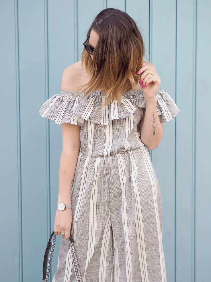Striped jumpsuit frill bardot outfit with trainers and Chanel boy bag