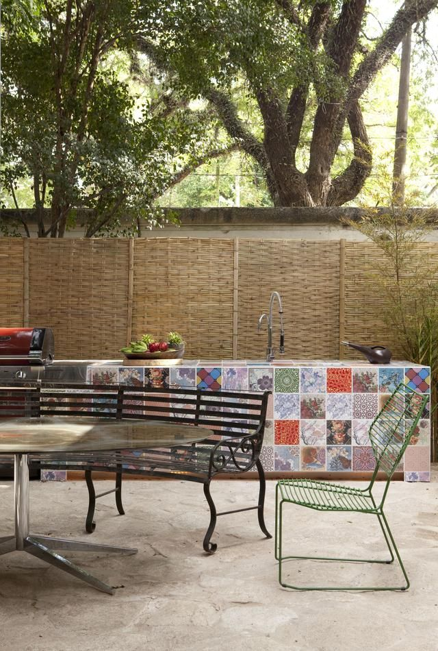 mix and match tiles shine in this outdoor kitchen - Patio Tiles Ideas