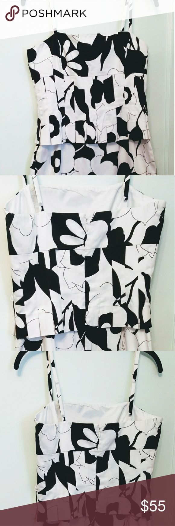 """Nine West Black & White Spaghetti Strap Dress EUC This flirty tropical print black & white sundress would be perfect for a summer wedding. It has adjustable spaghetti straps and a lined bodice. The waist is accented with a pleated peplum. The pencil skirt has a 3"""" slit in back. The closure is with a back hidden zipper. The waist also has a thin black belt that slips through intact loops at each side. Fabric: 97%cotton, 3% spandex. Dry Clean only. Measurements: strap to strap 10""""; armpit to…"""