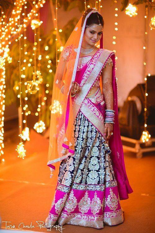 Indian bride wearing bridal lehenga and jewelry. #IndianBridalHairstyle #IndianBridalMakeup #IndianBridalFashion