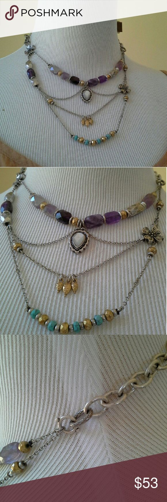 """LUCKY BRAND Necklace >>> ONLY 1 LEFT! <<< Lucky lucky lucky! The goes-with-everything necklace. Asymmetrical chain pattern. Silver, gold, with dark and light faceted purple amethyst stones, and small faceted turquoise colored stones. APPROX MEAS: 16.5"""" chain. Bottom chain hangs approx 4.5"""" below the center. The dogwood flower beads are 9/16"""" square for reference. Only 2 available. Lucky Brand Jewelry Necklaces"""
