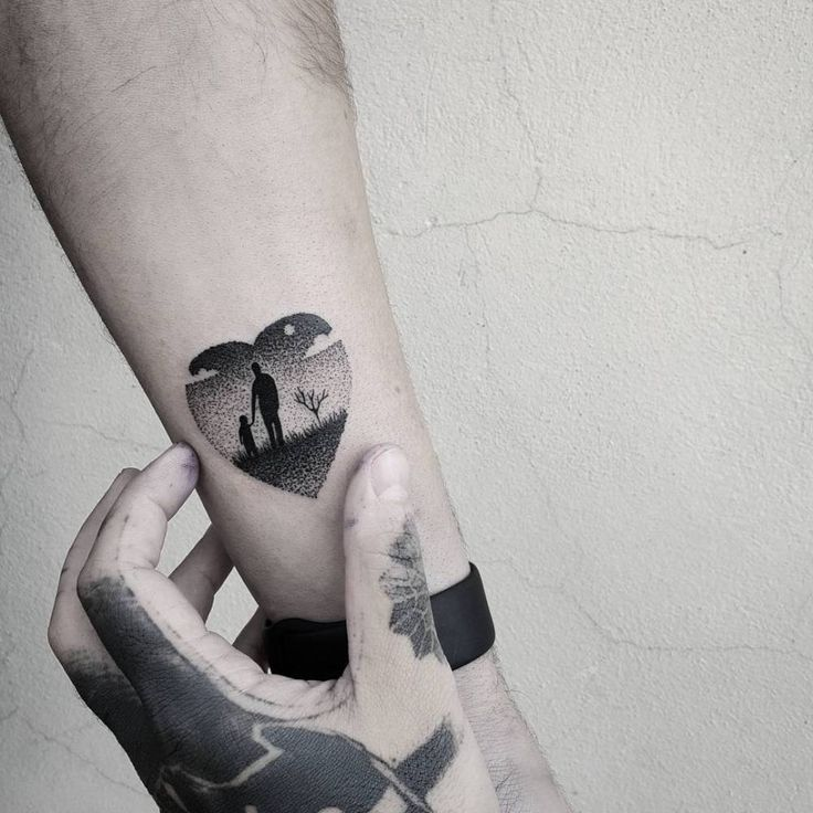 Heart shaped father and daughter landscape tattoo. Tattoo artist: Matteo Nangeroni
