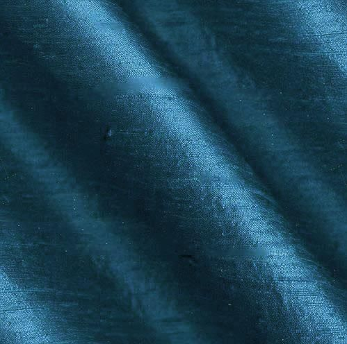 Dupioni Silk Fabric Iridescent Teal Blue from @fabricdotcom  Dupioni silk fabric has a lustrous sheen and characteristic small slubs that run horizontally across the fabric. It falls in soft folds when draped and is the most versatile fabric we carry. Not only do many brides choose dupioni silk fabric for themselves and their bridesmaids, it is also perfect for blouses, jackets, skirts, handbags and dresses. Be creative with beautiful home decor accents (draperies, swags, pillows and duvet…