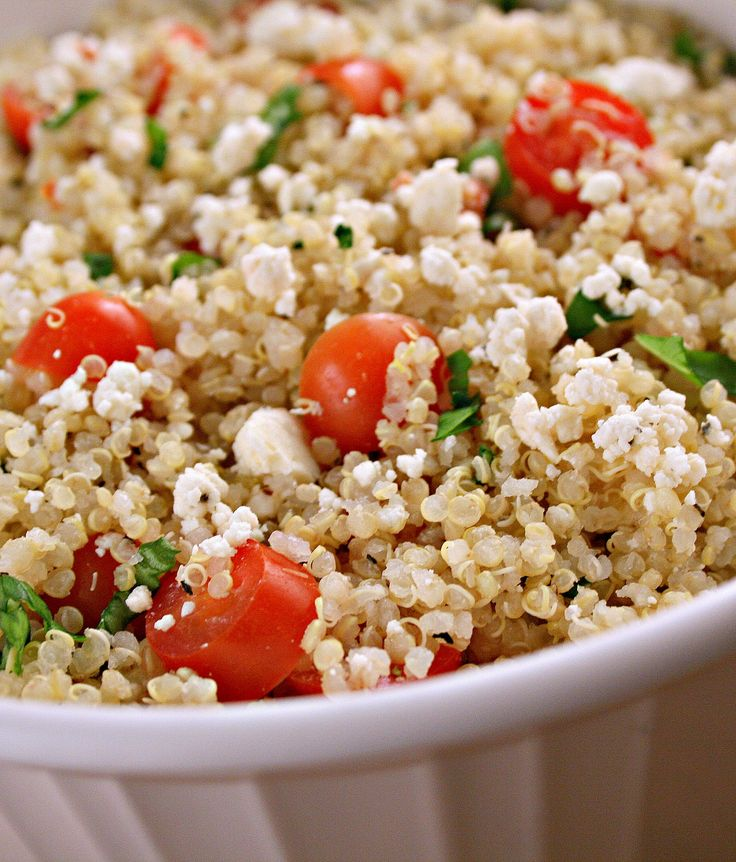 Tomato, Basil & Feta Quinoa Salad - FoodBabbles.com I added cucumber and kalamata olive.  The dressing was lemon juice, olive oil, salt and oregano.  So tasty!