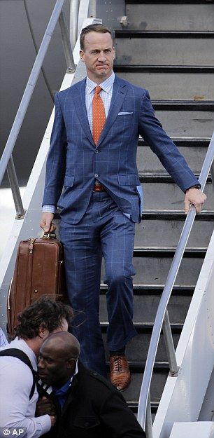 Denver Broncos' Peyton Manning arrives in San Jose in a dapper blue suit with an orange tie ahead of Super Bowl 50