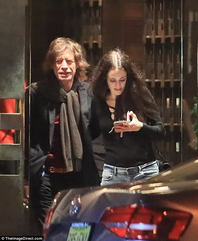 Sweet: Mick Jagger and Melanie Hamrick looked every inch the doting parents as they spent ...