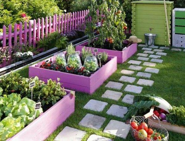Gemüsebeet planen mit Wegen zwischendurch Steine mit Rosa beeten