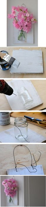 DIY Mason Jar Wall Vase; 1. Paint a piece of plywood 2, screw tiny holes in plywood to weave wire through, creating a mount for your jar as well as a mount for the wall. 3. Wrap wire around lip of jar, stick through the holes and twist wire ends together on reverse side. 4. Twist wire through top holes to create wall mount. 5. Fill jar with flowers, hang and enjoy. love it must try! #ecrafty