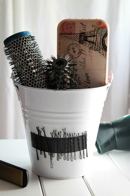 Good idea for storing brushes and bobby pins!.... Could add the magnetic strip to the mason jars I already use