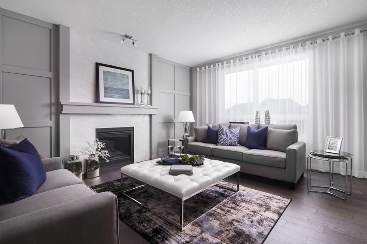 Living room in the Tofino III showhome in West Grove Point in southwest Calgary by Shane Homes.  #familyroom #livingroom
