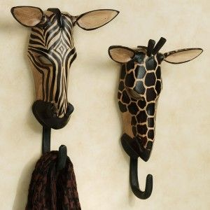 "The Exotic Tribe Zebra and Giraffe Wall Hook Set is a rare treasure, evoking the wild majesty of the savannah and the noble creatures that call it home. Handcarved in Kenya by Akhamba tribesmen, these unique safari animal wall hooks are skillfully fashioned from tropical Neem wood. Handpainted wall accents have a black hook on the bottom. Each is approx. 8.5""Wx12""H.    •Two-piece animal wall masks set (zebra and giraffe)  • African wall Masks are handcrafted in"