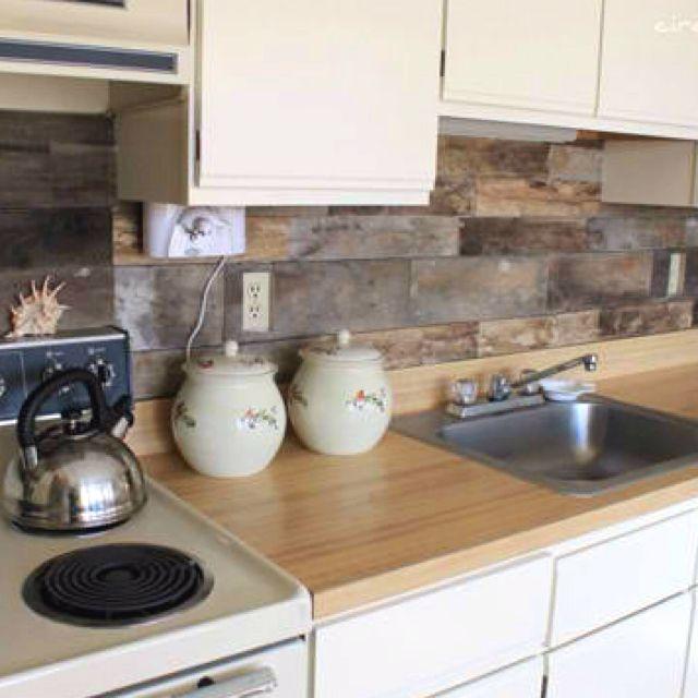 Reclaimed wood pallet backsplash - definitely doing this to my kitchen