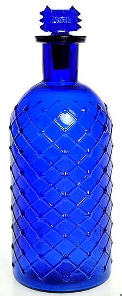 A lattice and diamond pattern poison bottled in deep cobalt blue with original top.
