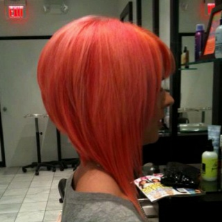 Coral hair....I'm totally doing a color like this on my new apprentice!