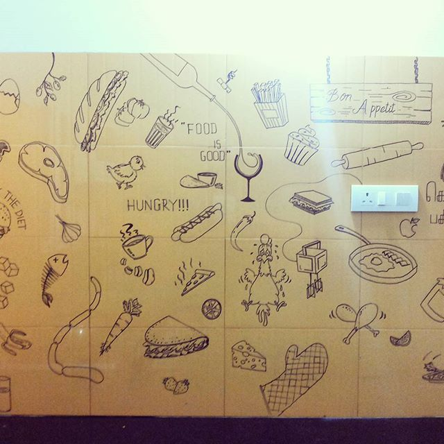 Doodle art @ our kitchen wall. #doodle #art #kasi #markerjob #multicuisine #yellow #gloves #hamburgers #lime #beater #milk #chickenstory #wineglass #garlic #sausage #sandwich #idly #kolapasi #foodisgood #bonappetit #hotdogs #dosa #permanenmarker #coffee #pizza #tacos #noodlesbowl #mushrooms #tomato Idea by me Doodles by @viswanathankasi
