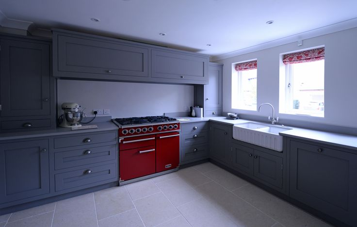 A lovely combination of grey, red and white with this hand painted Hallwood Furniture kitchen in Northamptonshire, England.