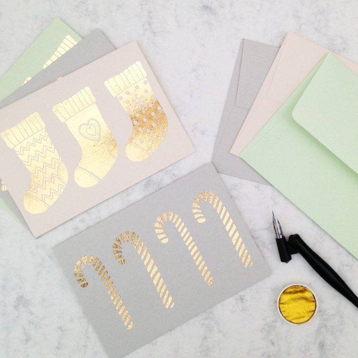 Gold Foiled Pastel Christmas Card Set.  This luxury Christmas card set uses high quality card stock and features a gold foiled illustration.  Each card is screen printed and foiled by hand.  Cards are also available individually.