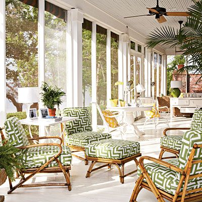 Love the crisp greens, whites and greek key pattern on rattan of this screened in porch.