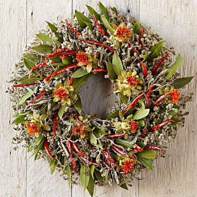 Red Chili Wreath #williamssonoma -Dried red chilies and orange safflowers deliver bold strokes of color amidst a bed of fragrant dried herbs including marjoram, sage, savory and bay leaves.
