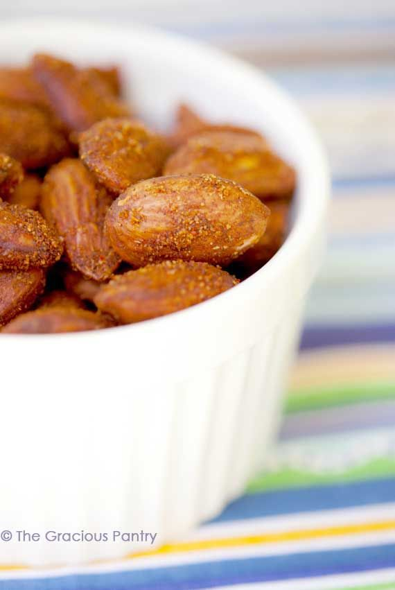 Clean Eating Spicy Roasted Almonds 1 cup raw almonds 1 1/2 tsp. olive oil 1 tsp. garlic powder 1 tsp. paprika 1/2 tsp. cayenne 1/2 tsp. cinnamon 1/4 tsp. salt or to taste   Read more: http://www.thegraciouspantry.com/clean-eating-spicy-roasted-almonds/#ixzz3RexWBGgr  © The Gracious Pantry. All rights reserved.