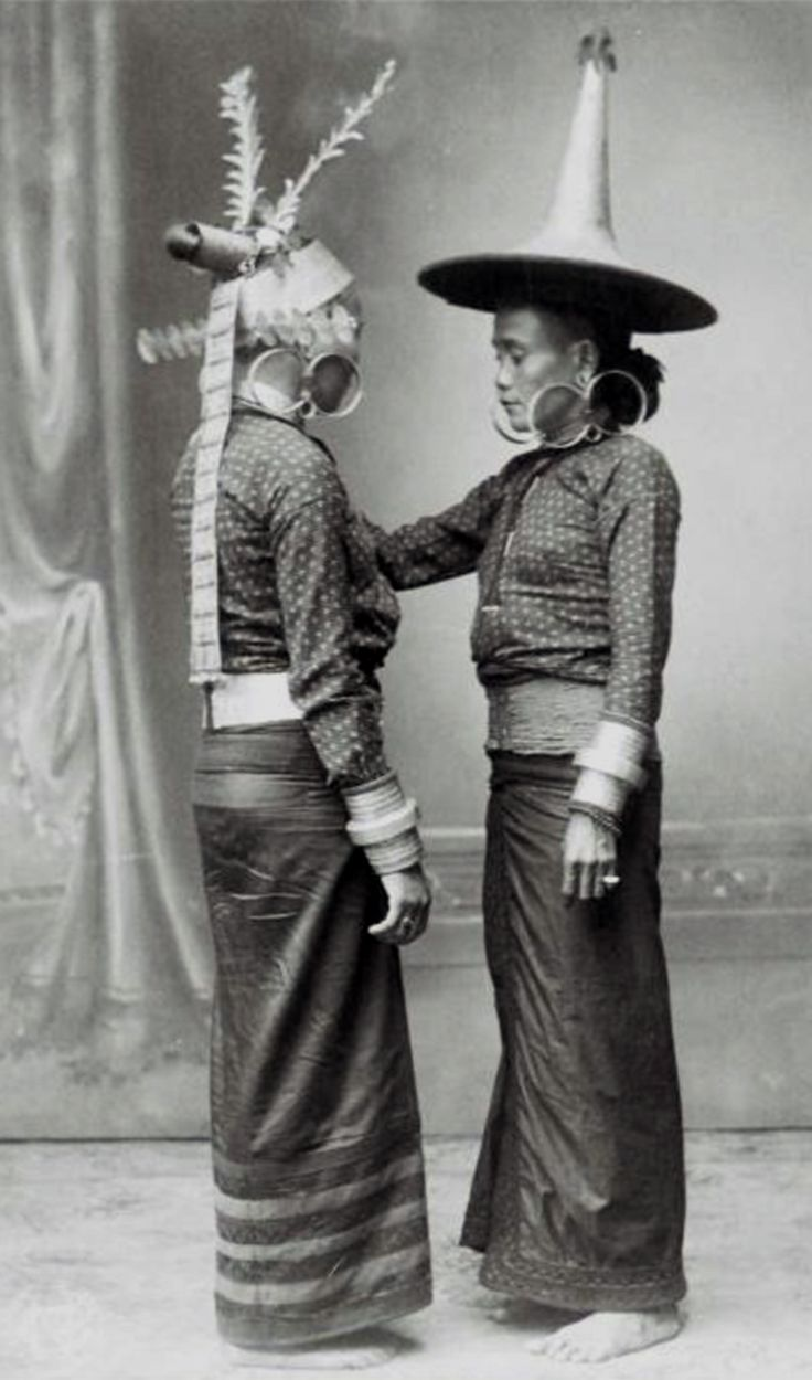 Indonesia ~ Sumatra, Nais | Studio portrait of two women from South Nias in dance costume. ca 1892 - 1922 | ©Christiaan Benjamin Nieuwenhuis