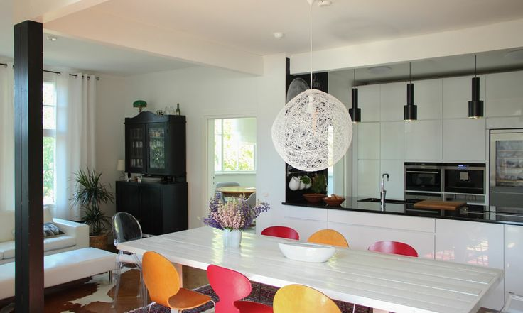 Runner-up in the 'most beautiful home in Finladn 2013' competition organised by MTV 3 channel.  Love the colourful chairs!