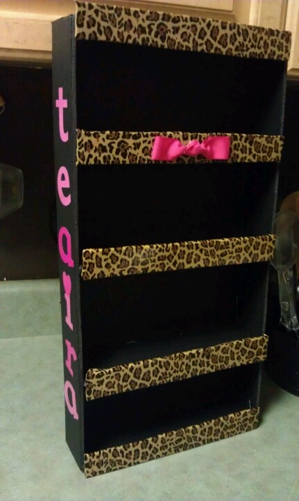 DiY Leopard Nail Polish Holder Rack - All you probably need are about 2 foam boards, glue gun, tape with the design you want(or cheetah tape) or something else you want to use like fabric. You will also need a ruler, box cutter, and decorate it however you want.