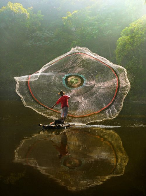 This is a beautiful shot. I watched men in the Amazon throw these nets for hours, it's so graceful -  like watching a dance. They gather them back in immediately (from a central rope), sometimes with a few fish inside and prepare to throw the net again. It's a tough life.