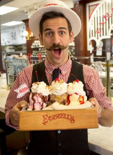 Jake Koeppl, Farrell's Fountain Artisan displays the Farrell's Famous Pig's Trough Sundae. It's big enough for two...you and you! (PRNewsFoto/Farrell's Ice Cream Parlour ...)
