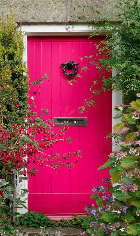 Hot pink door on Shaftesbury, Dorset, England - wouldn't this make you happy to come home!