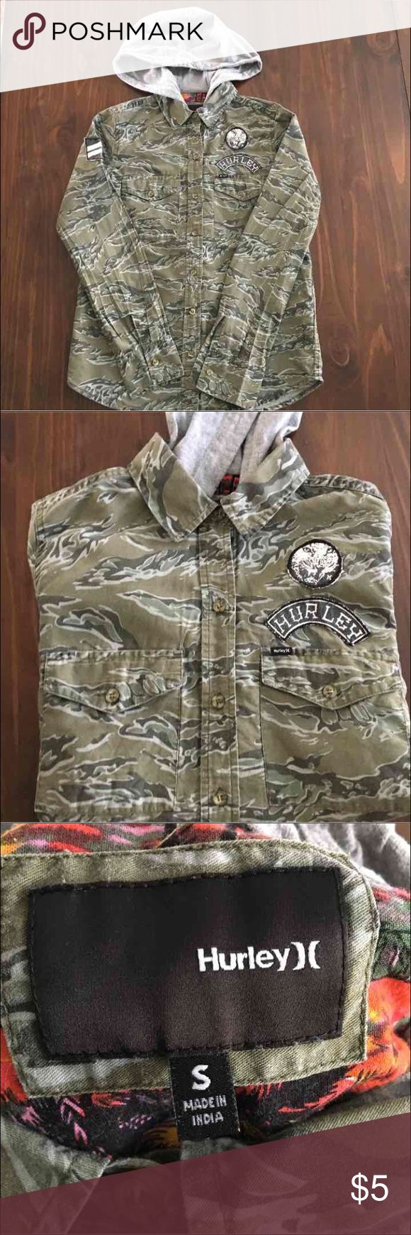 Camo shirt Button up camo shirt with hood. Has patches on front and sleeve. No damage. Size is a female S but I think this can be a unisex shirt. Hurley Tops Button Down Shirts