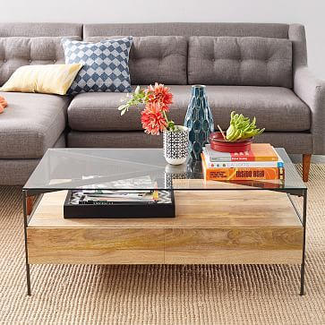 "Glass-Topped Rustic Storage Coffee Table. $699. 44""w x 24""d x 18""h. Solid mango wood w/ brass finish.  Clear glass top; blackened steel frame. Family Room."